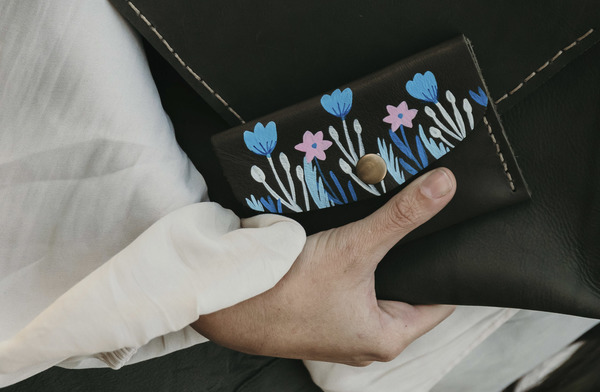 PLEASE NOTE THAT WE HAVE A 7 -14 DAY PRODUCTION LEAD TIME FORALL PRODUCTS, AS THEYARE MADE TO ORDER.  The Minipurseishand crafted usinglocally sourced leather. It is hand painted using a specially formulated leather paint. As the pattern is hand painted, please expect slight variations from product to product.  Dimensions: H 9cm x W 13cm x D 0.5cm  Features a press stud closure and an internal division. Perfect for coins, cards and notes, or small valuables and trinkets.  Please note thatIlundi products aremade with the finest quality materials available. Any irregularities in the colour or in the grain are normal characteristics of natural leather. Leather items may have wrinkles, scars or scratches, that are an inherent quality and natural beauty of the hide.    SHIPPING:  South African orderssent withDawn Wing, 2-3 working days (over and above the production lead time). International orders sent via DHL. Fees automatically calculated at checkout.All customs fees to be paid by the receiver.
