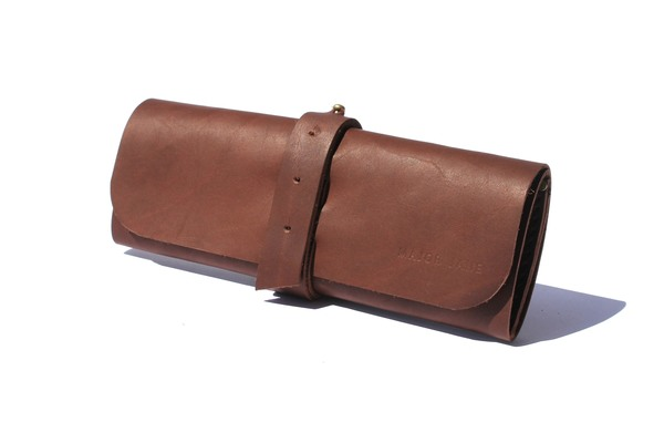 Chocolate, Tan and Black Genuine Makeup Roll  Our Make-up Roll has two pouches for blush and eye shadow, It has 4 big and 4 small pouches for mascara, lipstick and pencils etc.  Size: 38 x 24cm  If we don't have stock available please email info@majorjohn.com to order.  The Make-up Roll does not include the makeup