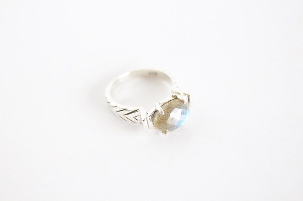 Hand carved ring with line detail on band set with Labradorite  -Solid sterling silver  - Set withLabradorite  All our jewellery is handmade in our Cape Town studio from .925 sterling silver.  Check our Info Page for info on Sizing.