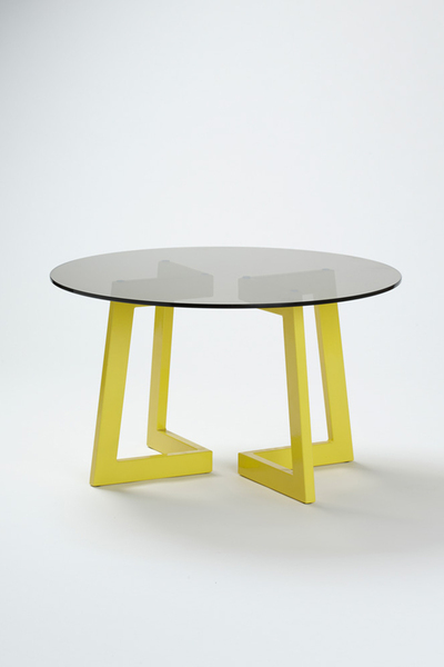 A subtle black tinted glass top creates an eye-catching contrast to the yellow leg structure. The epoxy coated leg structure can be configured in multitude of various ways, allowing the user to become apart of the final design and configuration.    Materials: Black tint glass, Yellow epoxy coated steel  Epoxy colours: White, Black, Grey, Blue,?Red & Yellow.   Dimensions: 800mm D x 465mm H