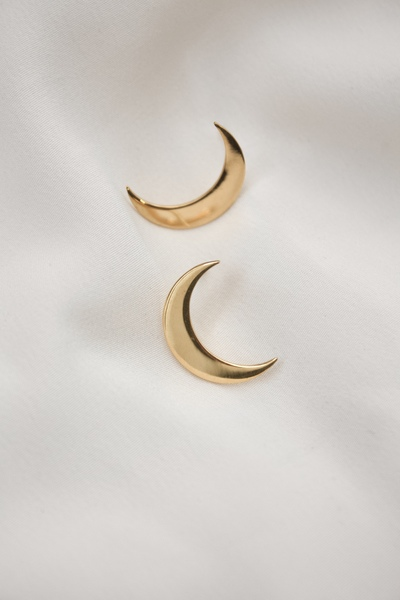 The Crescent Moon Earring  The lucky side of the moon.  - Material: 18k gold plated brass  - Approx. 2cm long  - Sterling silver ear pins  - Earrings come as pair  All our jewellery is handmade in our Woodstock studio.