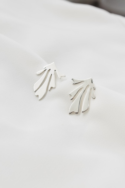 This is part of our Matisse inspired series  Modern and elegant earring that is great for miss matching with other earrings from this collection.  Have some fun,wear art every day!  The earring is made out of pure .925 sterling silver and sterling silver ear posts to make it super sterile and skin friendly.  Available in agold plate option. All ourgold plated jewellery has a base of sterling silver.  Handmade in our Cape Town Studio.