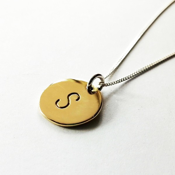 PUNCH DISCNecklaces are hand stamped on a brass, copper or silver disc. They are 10mm 15mm or 20mm in diameter.  They come on a sterling silver chain in the length of your choice (40, 45, 50 or 55 cm)!  We have 3 letter sizes available: 1mm, 2mm and 6mm. Please specify which size you would like when placing your order, as well as the letter or wording you would like on your disc.  Every necklace purchased is packaged in a jewellery box, making it ready for gifting.  As necklaces are custom made to your specifications, please allow 3-5 working days for manufacturing and 3-4working days for delivery.  Please supply your choice of chain length when placing your order! (See our FAQ section), as well as the name / initial you want stamped on your ring!  *PLEASE NOTE: Letters are stamped by hand. We can't guarantee perfection, but we can guarantee that attention to detail is of the highest importance when creating your jewellery piece.
