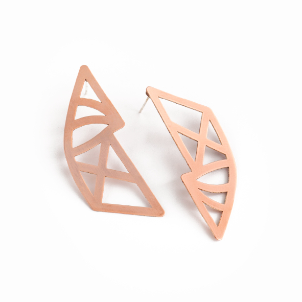 Upside down, topsy turvy reflections of each other, these Geo earrings are our mirrored curved beauties representative of the unexpected curves to be found in Cape Town's architecture. Available in polished brass, with sterling silver studs. Size: 4.8cm long x 2cm wide