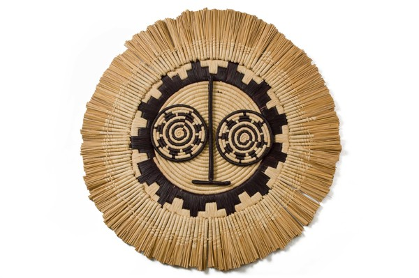 The inspiration for these raffia woven wall art pieces, are derived from woodenSunMasksmade by the Bwa people of Burkina Faso. They are worn during dances performed in agriculturalceremonies to celebrate the farming season and promote an abundant yield.  A multitudeof techniques and expert hand weavingskills are used to create these striking pieces.  68cm in diameter  All products are made by hand with love and vary slightly in color and size. Made in an ethical, fair trade environment by women in Uganda, supported by All Across Africa  CARE INSTRUCTIONS:   Woven masks and basketshave a hang loop on the back - ready to hang aswall décor Keep dyed products out of direct sunlight to avoid fading To clean,use a damp cloth. Avoid using chemicals or detergents. Do not submerge in water as the natural dyes could run. In case the wall art gets wet, pat dry and air out to avoid mould growth.