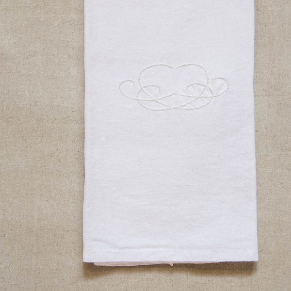A stylish hand-embroidered utility cloth. Use this wonderfully soft cloth as a tea or guest towel, to wrap warm bread, line a picnic basket, cover food before serving or simply as a beautiful display piece.