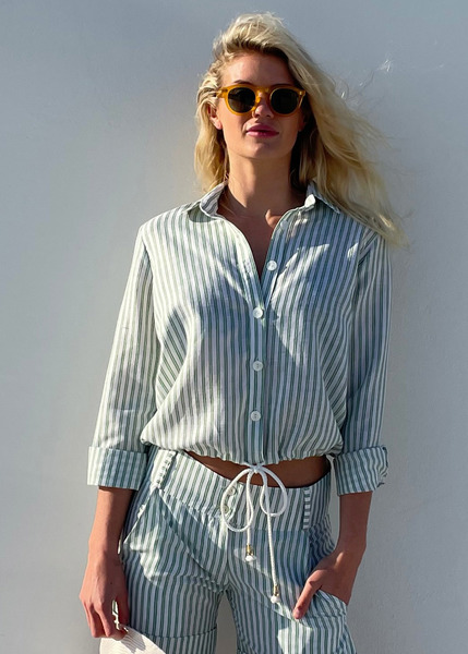 This beautiful white and green stripe linen is 45% linen and 55% rayon, crisp andsoft to the touch. The Shacket cut ends justbelow waist line ((sits on upper hip point) but can be worn shorter when tied higher in the waist. The shacket is a classic cropped shirt style with cord tie and gold cord ends. Buttons are tortoise shell (white) Sleeves are long with a classic cuff (worn rolled up in picture)  Fabric has been pre washed for shrinkage. Do not Tumble dry. Cold hand wash only.