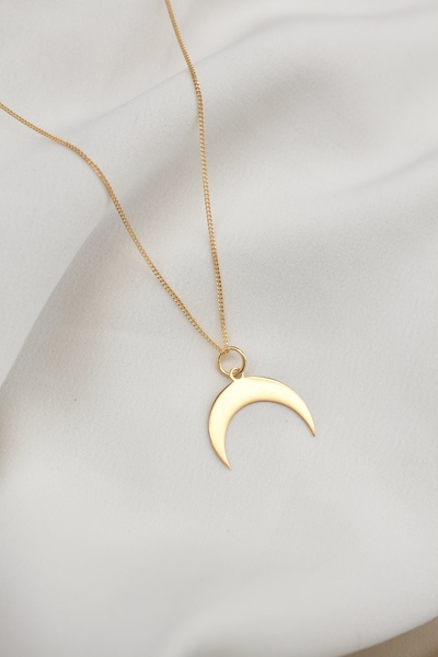 The Crescent Moon Necklace  The lucky side of the moon.  - Material: Brass Crescent moon gold plated brass pendant on gold plated sterling silver chain  - Approx. 2,5cm long  - Chain length: 45cm  All our jewellery is handmade in our Woodstock studio and is nickel free.
