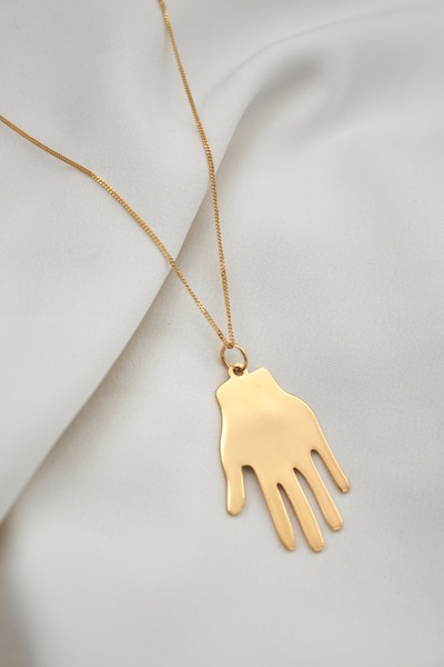 This necklace features a brass Palm pendant on a gold plated chain.  - Material: Brass Palm pendant on gold plated sterling silver chain  - Approx. 4cm long  - Necklace hassterling silver chain option  - Chain length: 45cm  All our jewellery is handmade in our Woodstock studio.