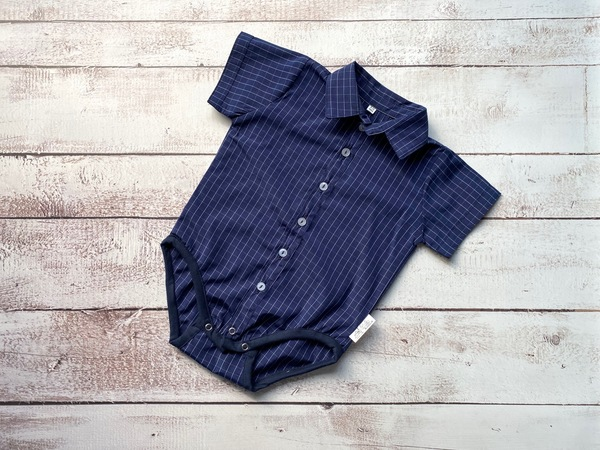 Navy and blue check button up shirt or babygrow.  Pair it with a bowtie or long tie, suspenders and shorts or chino pants  All products are handmade locally.  Shipping can take up to 7 days.  Please contact us if you need the products sooner.