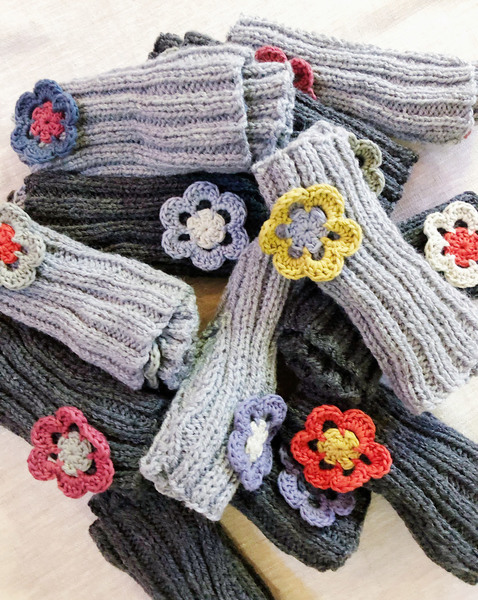 Keep your hands warm and your fingers free to carry on with their jobs this winter. These beautiful hand knitted hand warmers with crochet flower detail are the perfect companions while doing creative work or spending time behind the computer.  Light grey hand warmers with slate and blue flower detail.  One size fits all.  Handmade in South Africa.  Delivery:  Courier delivery in Cape Town within 5 business days: R50 per order Courier delivery to the rest ofSouth Africa within 5-10 business days: R65 per order