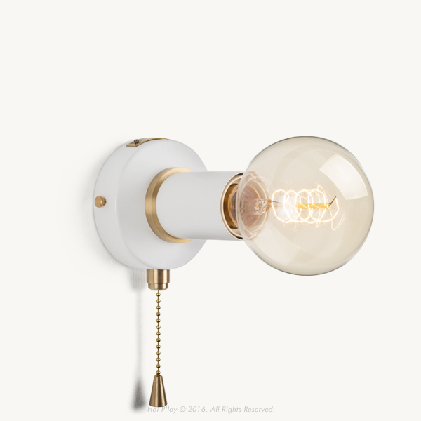 A simple yet discerning light that forms part of our colour rich range with subtle brass detailing. Initially designed as a minimal wall sconce, now has a switching on and off function with a pull chain mechanism. It is available in 5 pastel colourways as well as classic metal finishes such as brass and gunmetal grey which are made of solid brass.