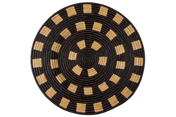 A multitudeof techniques and expert hand weavingskills are used to create these striking pieces.  68cm in diameter  All products are made by hand with love and vary slightly in color and size. Made in an ethical, fair trade environment by women in Uganda, supported by All Across Africa  CARE INSTRUCTIONS:   Woven masks and basketshave a hang loop on the back - ready to hang aswall décor Keep dyed products out of direct sunlight to avoid fading To clean,use a damp cloth. Avoid using chemicals or detergents. Do not submerge in water as the natural dyes could run. In case the wall art gets wet, pat dry and air out to avoid mould growth.
