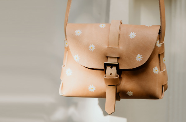 PLEASE NOTE THAT WE HAVE A 7 -14 DAY PRODUCTION LEAD TIME FORALL PRODUCTS, AS THEYARE MADE TO ORDER.  The Signature Sling Bagiscleverly folded without any stitching, hand crafted usinglocally sourced leatherand antique brass hardware. It has a buckle closureand an adjustable shoulder strap.It is hand painted in Cape Town using a specially formulated leather paint. As the pattern is hand painted, please expect slight variations from product to product.  Dimensions: H14cmx W 19cm x D 7cm  Please note thatIlundi products aremade with the finest quality materials available. Any irregularities in the colour or in the grain are normal characteristics of natural leather. Leather items may have wrinkles, scars or scratches that are an inherent quality and natural beauty of the hide.    SHIPPING:  South African orderssent withDawn Wing, 2-3 working days (over and above the production lead time). International orders sent via DHL. Fees automatically calculated at checkout.All customs fees to be paid by the receiver.