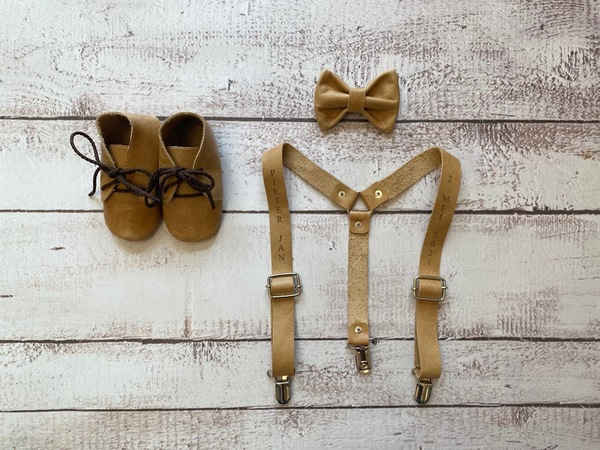 Leather suspenders - R150  Bowtie - R90  Dummy clip - R80  Shoesin the Accessories section.  Handmade locally.  Delivery takes 10 working days.