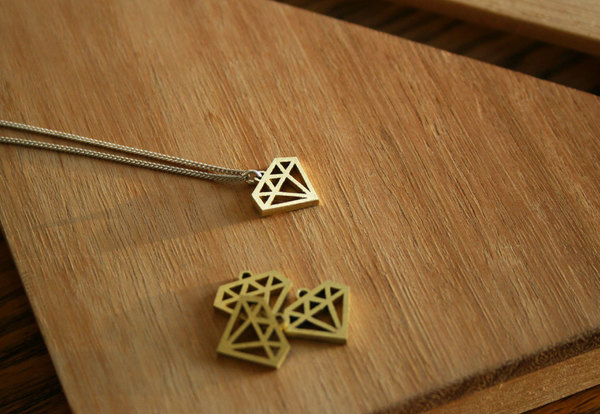 Brass diamond pendant with sterling silver chain.