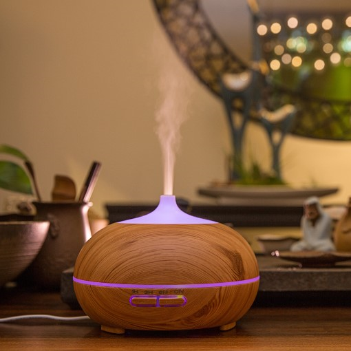 This lovelywood grain ultrasonic essential oil diffuser fills the space with a lovely fragrance that can lift the mood and relieve stress, perfect for masking stubborn smoking and pet odours, get great and peaceful nights' sleep surrounded by the aromatic fragrance.Features:Relax and enjoy – 7 colour changing lights provides a relaxing setting. You can choose your favourite colour or have the colours rotate.Simply add a few drops of your favourite essential oil to create a relaxingmind and body aromatherapy experience.Humidify – Dry air can cause your skin to crack. The diffuser can be used without essential oil to add moisture to the air.Auto shut off when the water runs low – adds to safety, energy efficiency and peace of mind.Four modes to diffuse mist – 1 hour, 3 hours, 6 hours or stay on.No filters required and works with ordinary tap water.Specifications:- Size: 17 x 13 (cm), 360g, not real wood- Capacity: 300ml- Working time: Up to 10 hoursBenefits of Using an Essential Oil Diffuser:- Wards of illness- Freshens up the air- Helps sleep- Keep you cool- Pain relief- Stress relieve- Mood elevating- Relieve snoring- Repels insects- Safer alternative to candles and incense- Mental focus*Use pure essential oils ONLY. Use any scent of your choice.Add item(s) to your cart below to proceed to the checkout process or email your order to info@aromadiffusers.co.za